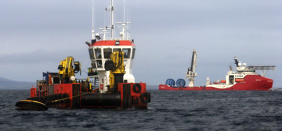 Two vessels laying cables in the Pentland Firth